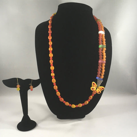 "Orange round beads, yellow stripped beads, and Butterfly embellishment.  Brass yellow clasp.  Necklace measures 28"" around.  Earrings included."