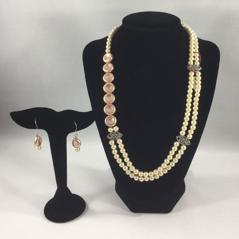"2 strand Ivory and Beige pearls. Sterling.  Necklace 20"".  Earrings included."
