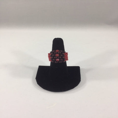 Red and Black Ring made with Glass Seed Beads.  Size 6.5.  Although this ring was strung with Fireline, constant water exposure while wearing is not recommended.
