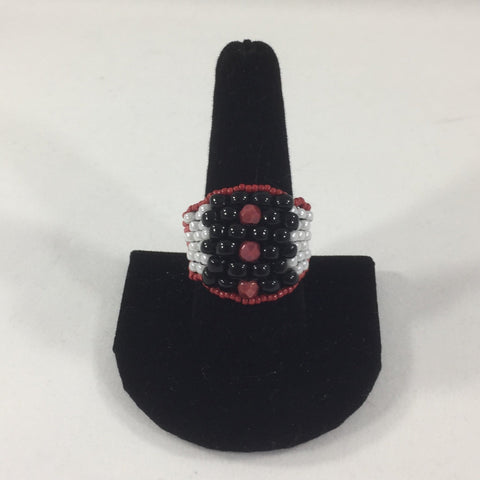 Red, Black and White Glass Seed Bead Weave.  Size 9.  Although this ring was strung with Fireline, constant exposure to water is not recommended.