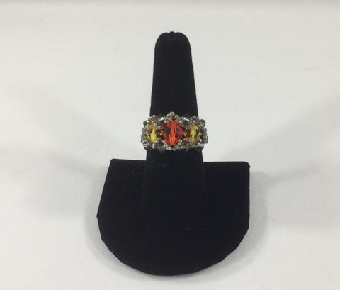 Beaded Ring with Orange Swarovski Bicone and 2 Yellow Swarovski Bicones. Silver Gray Glass Seed Bead Band.  Size 8 1/2.  Although this ring is strung with Fireline, constant exposure to water is not recommended.