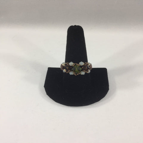 Beaded Ring, Green and Amethyst Swarovski Bicones with Opal Swarovski Accents.  Size 11.  Although this ring is strung with Fireline, constant exposure to water is not recommended.