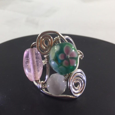 Ring, Sterling Wire Wrap with 3 Glass Beads, 2 pink and one green with a flower on it.  Size 9 1/4