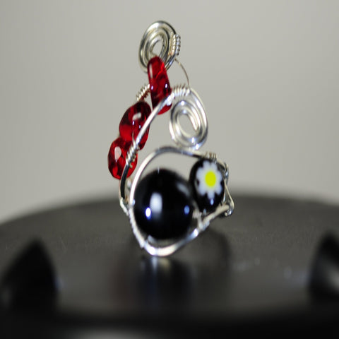 Ring, Wire Wrapped with red and 2 black beads.