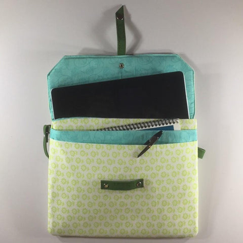 "Tablet/IPad Case, Pale Green Pattern, Snap Closure, 2 Spare Pockets in Front Under Flap.  Embroidered Flap.  Shoulder Strap.  Size H8"" W10-1/2"""