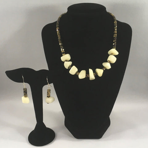 "Chunky white bead necklace with faceted gold tone beads.  Necklace measures 16 1/4"" around.  Earrings included."