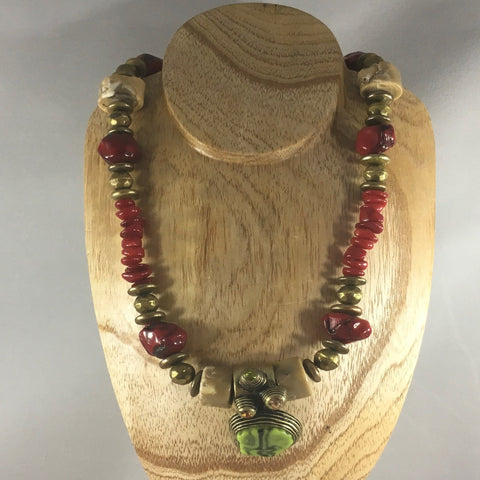 "Strung Necklace with Brass, Coral chips and Bone.  Necklace measures 18"" around.  Bracelet is 8"".  Bracelet and earrings included."