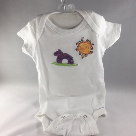 Baby Onsie for age 6-9mos.  Embroidered with a Purple Rocking Horse and the Sun