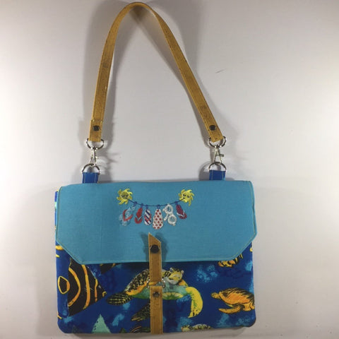 "Tablet/IPad Case, Ocean Theme, Snap Closure, 2 Spare Pockets on Back.  Embroidered Flap.  Shoulder Strap.  Size H8"" W10-6/8"""