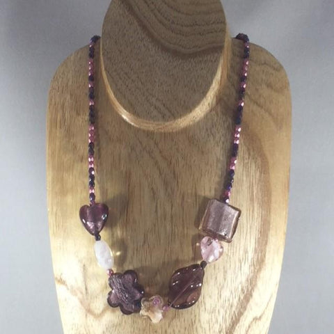 "Strung Necklace with Amethyst and Pink Czech Fire Polished Glass Beads and Shades of Purple Lampwork Beads.  Necklace length 19"".  Matching Earrings are included."