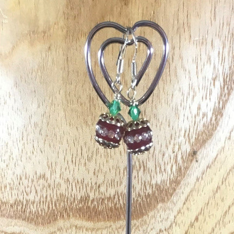 Pierced Earrings on Sterling Ear wires.  Red Sparkle Round Bead with Green Swarovski Bicones and silver bead caps, Sterling