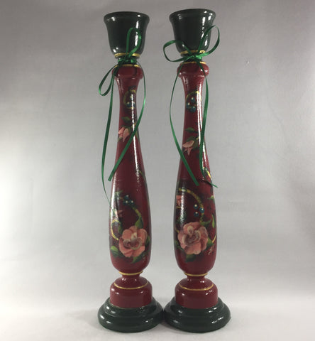 "Candlestick, Red and Green background with Christmas Roses.  Hand painted on turned wood with 6 coats of gloss.  Gold ring detailing.  Brass candle holder ring and felt padded on bottom to prevent damage to furniture.  11"" tall."
