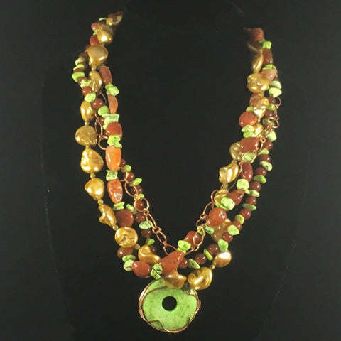 "Copper Path. 4 Strand Necklace with green turquoise stabilized chips, carnelian, gold fresh water gold pearls and copper. Necklace 24"".  Earrings included.  On sale."