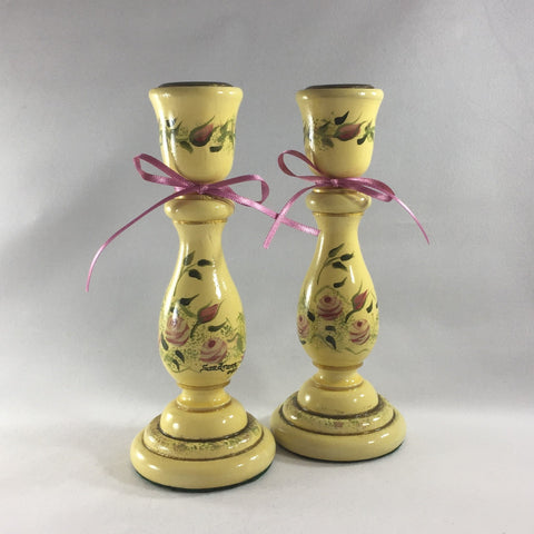 "Candlestick, Antique Cream background with pink Roses.  Hand painted on turned wood with 6 coats of gloss.  Brass candle holder ring and felt padded on bottom to prevent damage to furniture.  7"" tall."