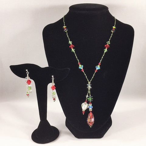 "Red and Green Christmas colors Swarovski's Necklace with a Tassel and Lampwork Beads.  Sterling.  Necklace 17 1/2"" with a 2 1/2"" drop.  Sterling post earrings included."