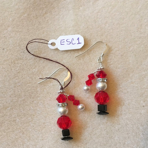 Pierced Earrings on Sterling Ear Wires.  Santa is made with a Red Swarovski Round Bead, a White Swarovski Pearl, a Red Swarovski Bicone and a Hat with Two Small Red Swarovski Bicones and a small White Swarovski Pearl.