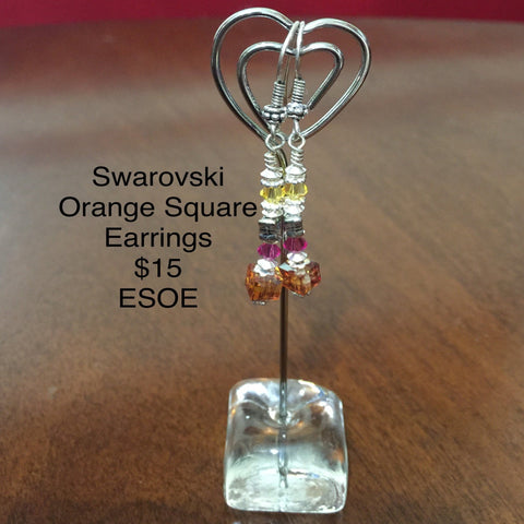 Pierced Sterling Silver Earrings with various Swarovski Crystals (Orange cube,  Fuchsia Round, Gray Cube and Yellow Bicone).  Sterling findings and Sterling ear wires.