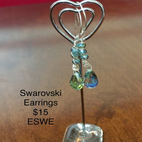 Swarovski blue beads with a wire swirl earrings. Sterling