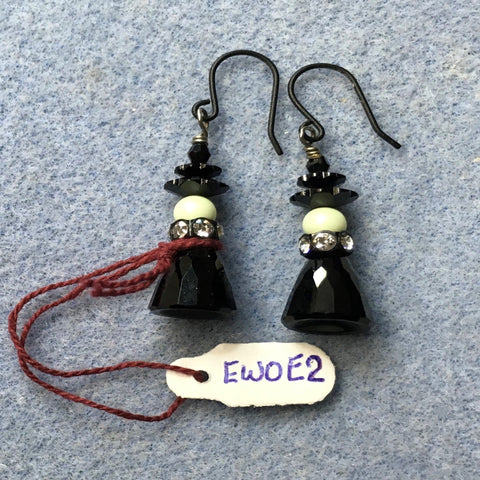 Pierced Swarovski witch earrings.  Black Ear wires.