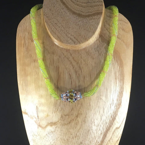 Green Hand Beaded Rope Necklace of Lime Green Glass Seed Beads with a hand made bead and Sterling clasp.  Matching Earrings included. Necklace 17 1/2""