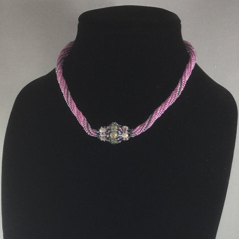 Pink Hand Beaded Rope Necklace of Pink Glass Seed Beads with a hand made bead with Czech Fire Polished Glass Beads, Rice Pearls and Glass Seed Beads.  Sterling clasp. Necklace length 16'""