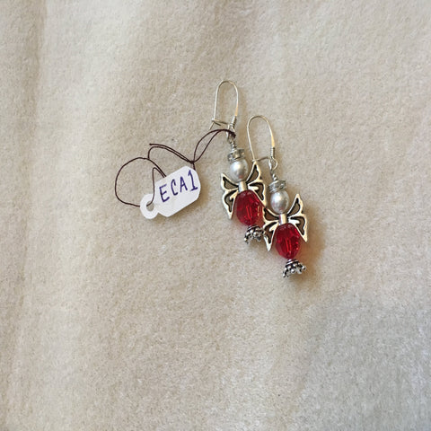 Pierced Earrings with Sterling Ear Wires.  The Christmas Angle is made with a Red Swarovski Round Bead, silver wings, and a White Swarovski Pearl.  Sterling.