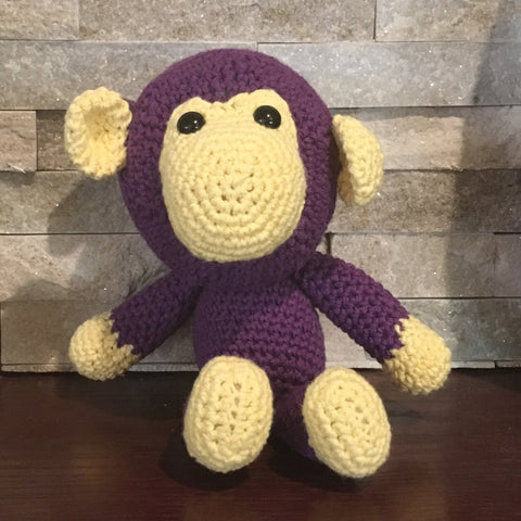 "Crocheted and Stuffed Monkey, Purple With Yellow Face.  Cotton Yarn.  11"" tall standing, 8"" tall sitting."