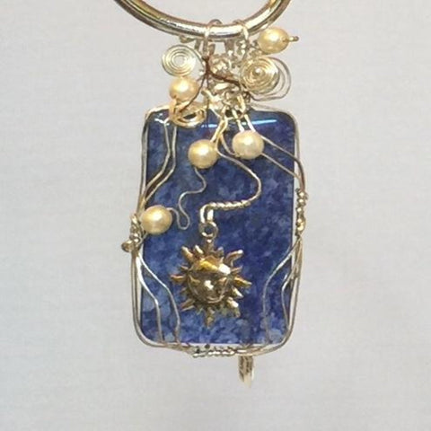 Wire Wrapped Blue Agate stone with Swarovski Pearls and a Sun Charm.  Sterling silver.