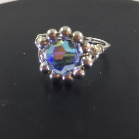 Ring, Sterling Wire Wrap with Sterling beds surrounding a Blue Glass Center Bead.  Size 6 3/4