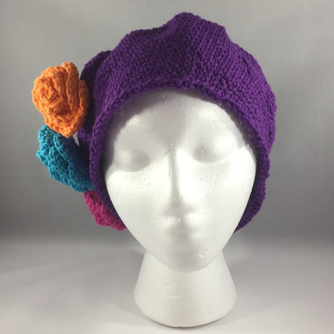 Crochet Hat,  Purple with Pink, Orange and Turquoise Flowers, Teen/Adult Extra Large.  Cotton Yarn.  Machine wash gentle cold.  Do not put in dryer.