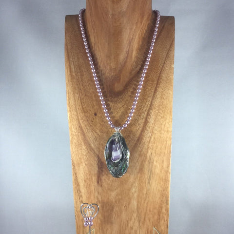 "Lavender/Pink shade Pearls, with Wire Wrap Shell Pendant, Sterling. Earrings included.  Necklace 19"" with a 2 1/2"" drop"
