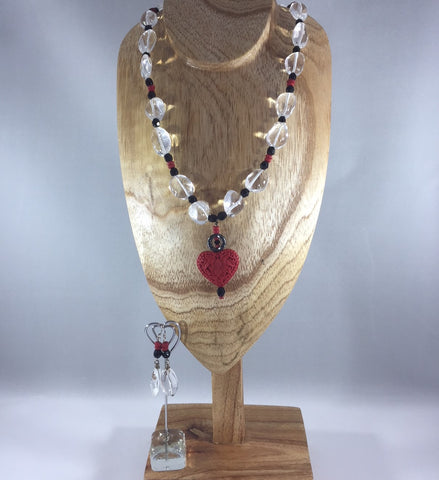 "Necklace Red Cinnabar, Sterling.  Was $36.00.  Now $18.00.  There are natural flaws in some of the stones.  This doesn't take away from the simple beauty of this necklace.  Earrings included.  Necklace 20"" with a 2"" drop."