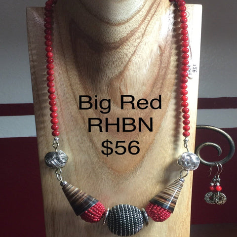 "Chunky Red Beaded Necklace with Horn accents, red round beads and a large silver center bead.  Necklace 20"".  Sterling Clasp and Ear Wires.  Earrings included."