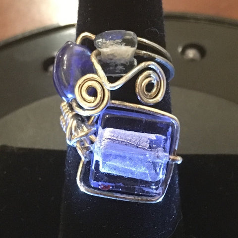 Sterling Wire Wrap, 1 Foil Blue Glass bead, and 2 additional blue glass beads.  Size 7 1/2