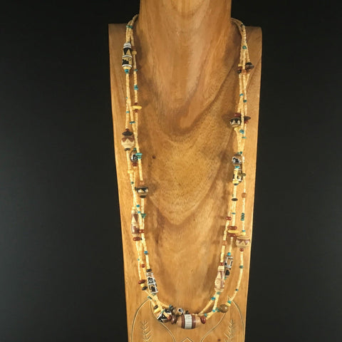 "Treasures of the Sierra Madre Cocopah Necklace. Collection of hand painted Southwestern clay beads, red Jasper, wood, bone, Peruvian Indian clay, Arizona Turquoise, and melon shell heishi. 30"". Sterling. Includes earrings."