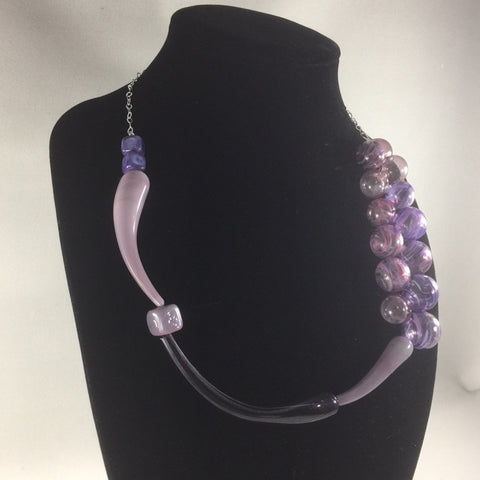 Hand Blown Glass Bead necklace with Sterling necklace chain.  These beads were hand-blown by Anna Scherbakova who lives in Russia. She used hues of purples to create each glass ball.  Then the balls were kiln annealed for hardness and finished with a dremel  The necklace measures 20""