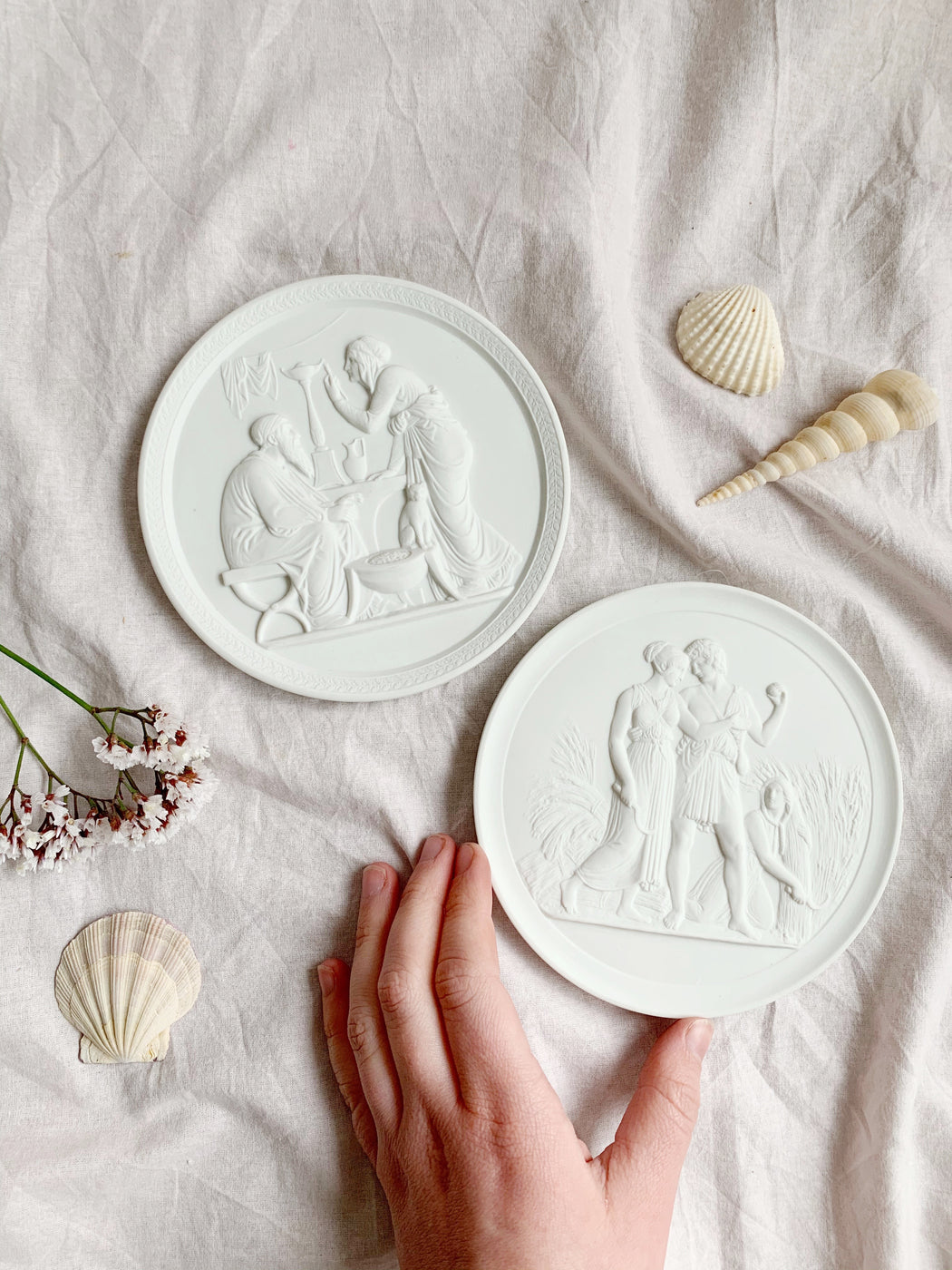 Pair of Summer and Winter Wall Plaques | Storytellers Workshop