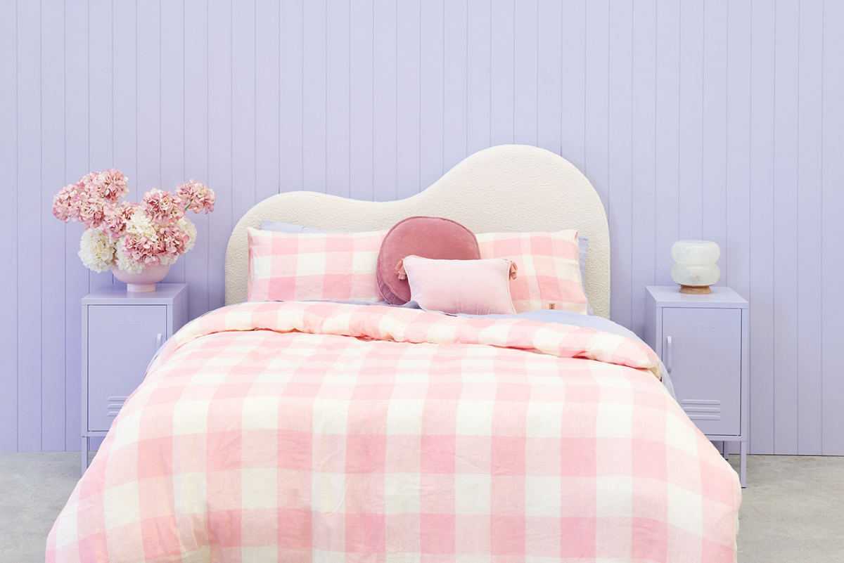 Styled Kip + Co bed in pink with Lilac Shorty locker either side