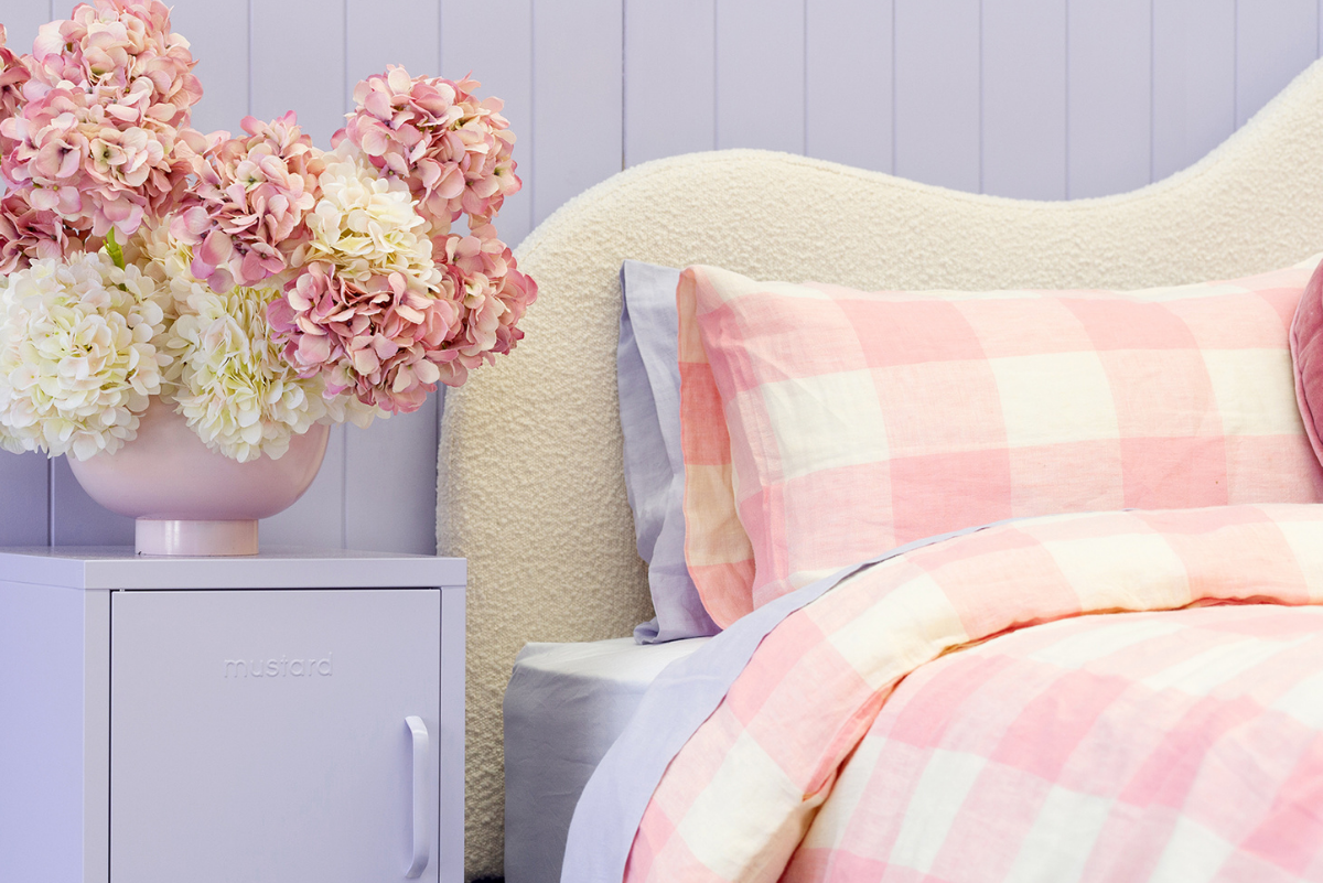 Styled Kip + Co bed in pink with Lilac Shorty locker either side - close up