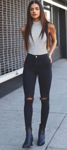 sleeveless top and ripped jeans for fall