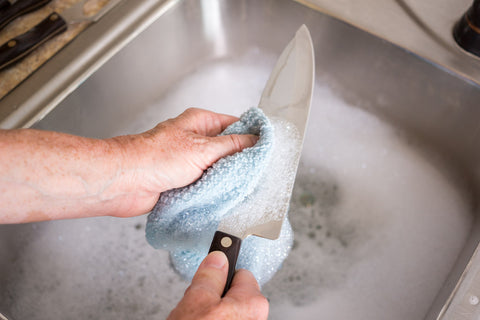 washing a knife