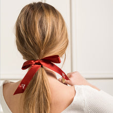 Personalised red ribbon with monogrammed embroidered initials