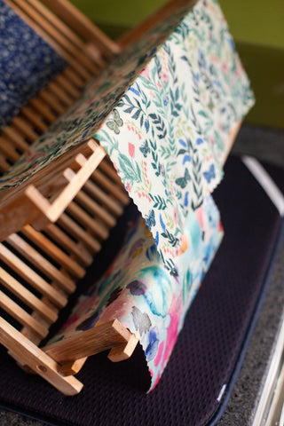 Beeswax wraps drying on a rack