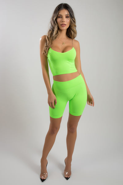 green top and bike shorts set