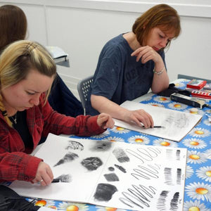 Students drawing with charcoal at Cardiff Artspace