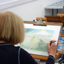 Woman drawing a landscape at an art class.