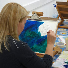 Woman painting during an art class.