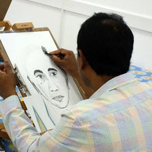 Man drawing a portrait during a course at Cardiff Artspace