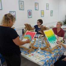 Art class for adults. Students painting.