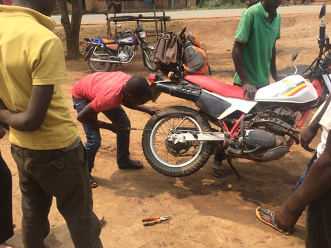 Bush Mechanics Fixing a Flat Tire